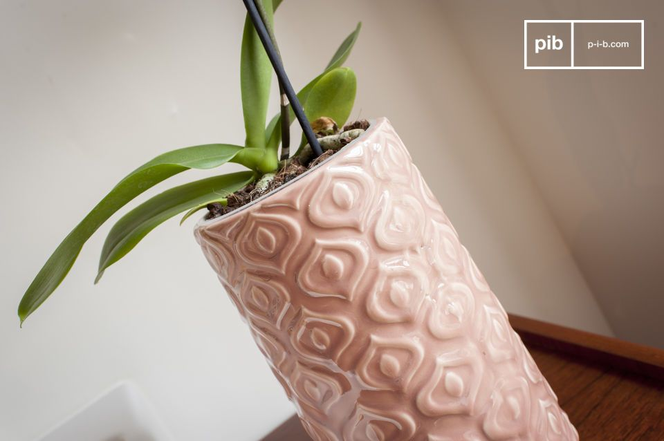 A pink ceramic vase worked in a vintage style full of softness