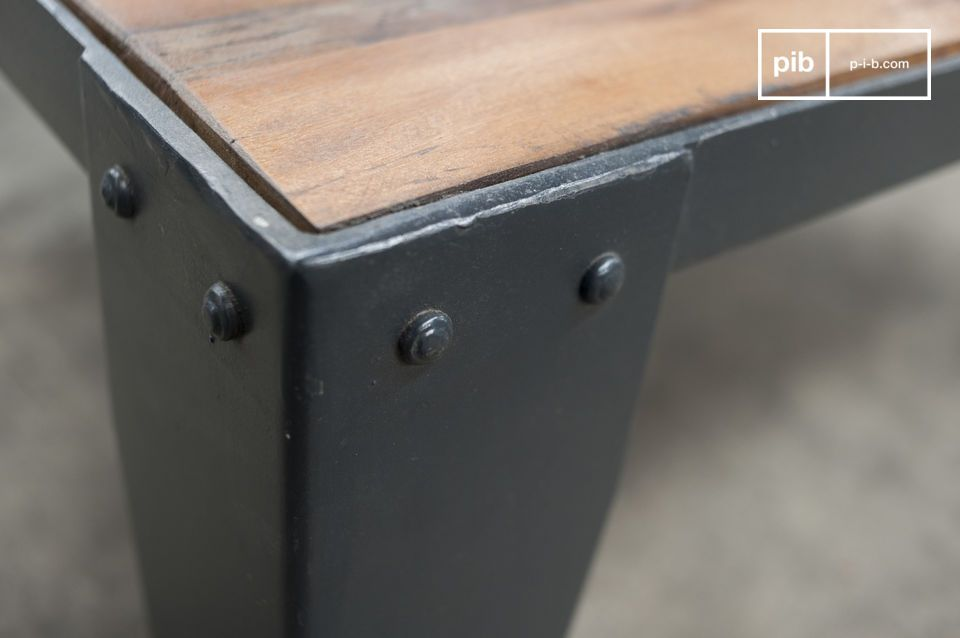 This coffee table is full of Industrial spirit due to the heavy cast iron wheels reminiscent of