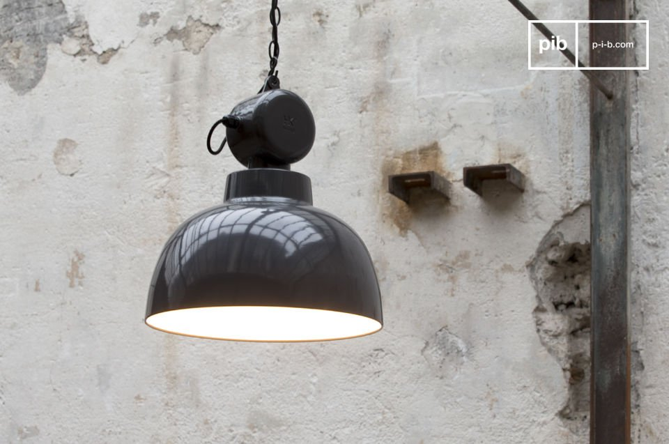 An industrial lighting design with its vintage satin gray color and metallic chain attached to the housing, as an industrial ceiling of the mid-twentieth century