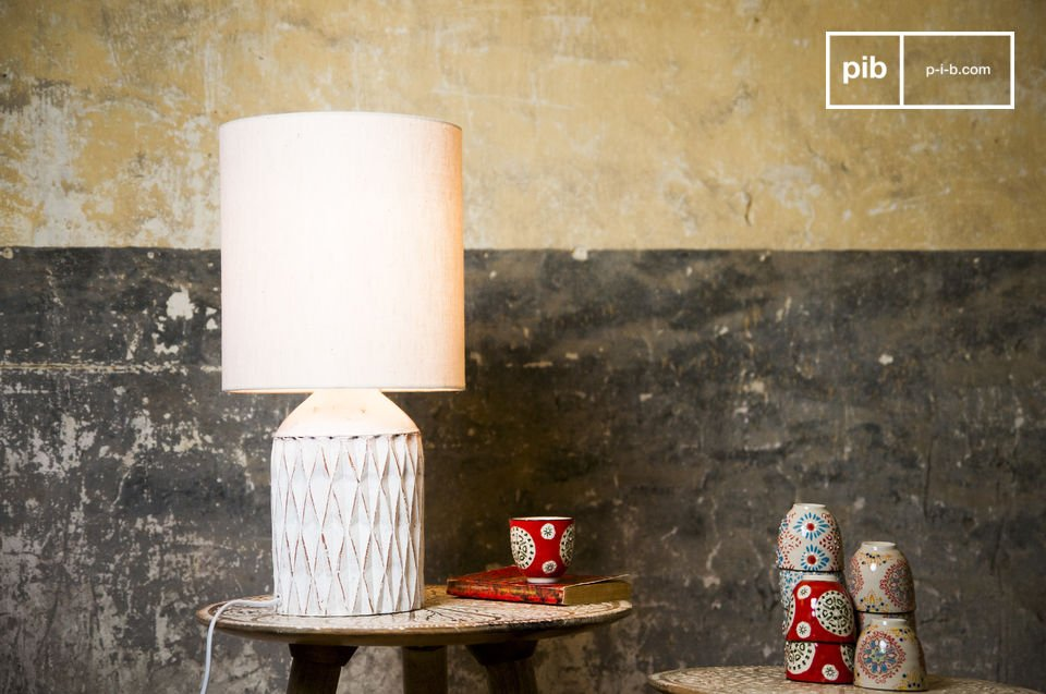 The Romeo lamp has a white patinated finish and is made out of  terracotta, which will surely give your home a romantic element