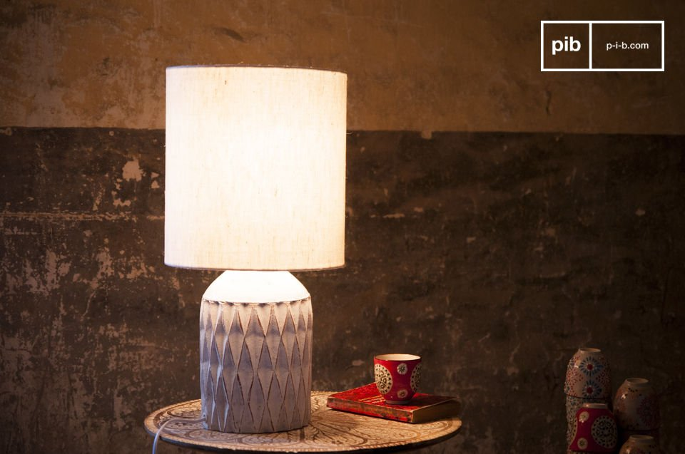 The Romeo lamp has a white patinated finish and is made out of  terracotta