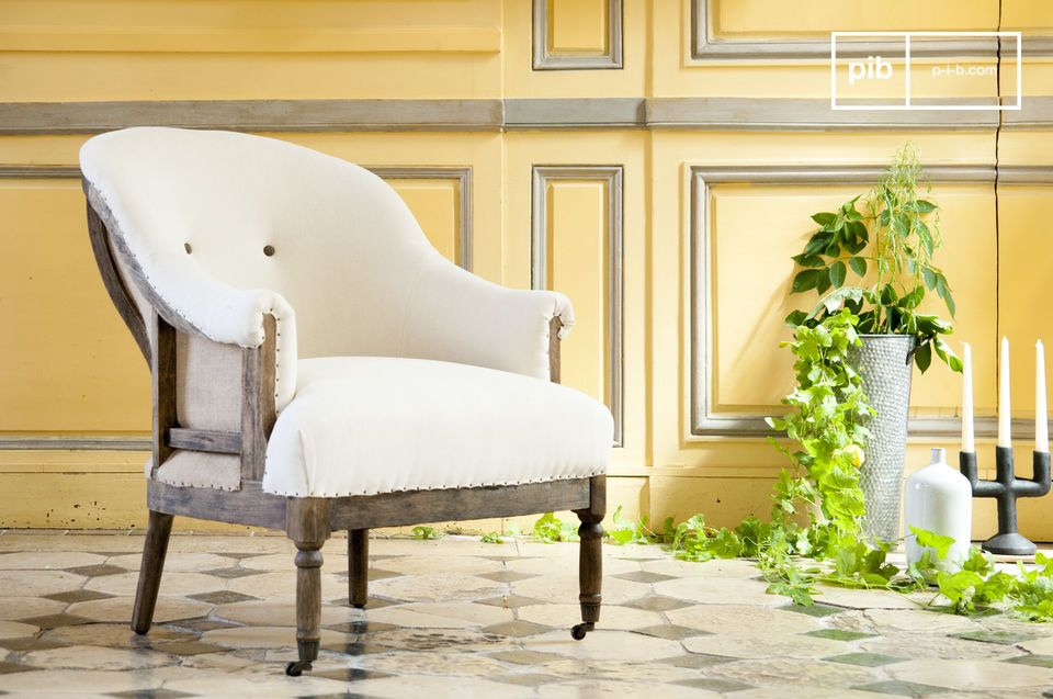 Beautiful white armchair in linen in country style.