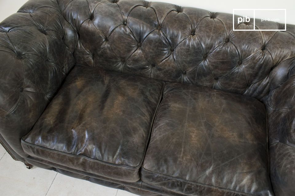 The top-grain leather has been given a slightly aged look and has been attached to a hardwood frame