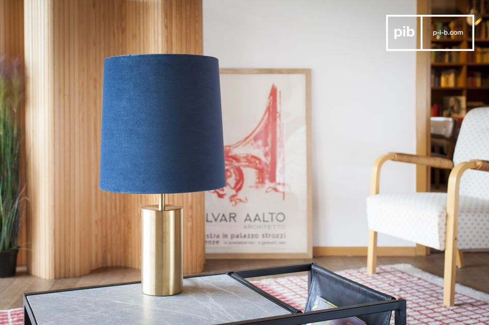 Pretty blue lamp with a golden foot inspired by the 60s.
