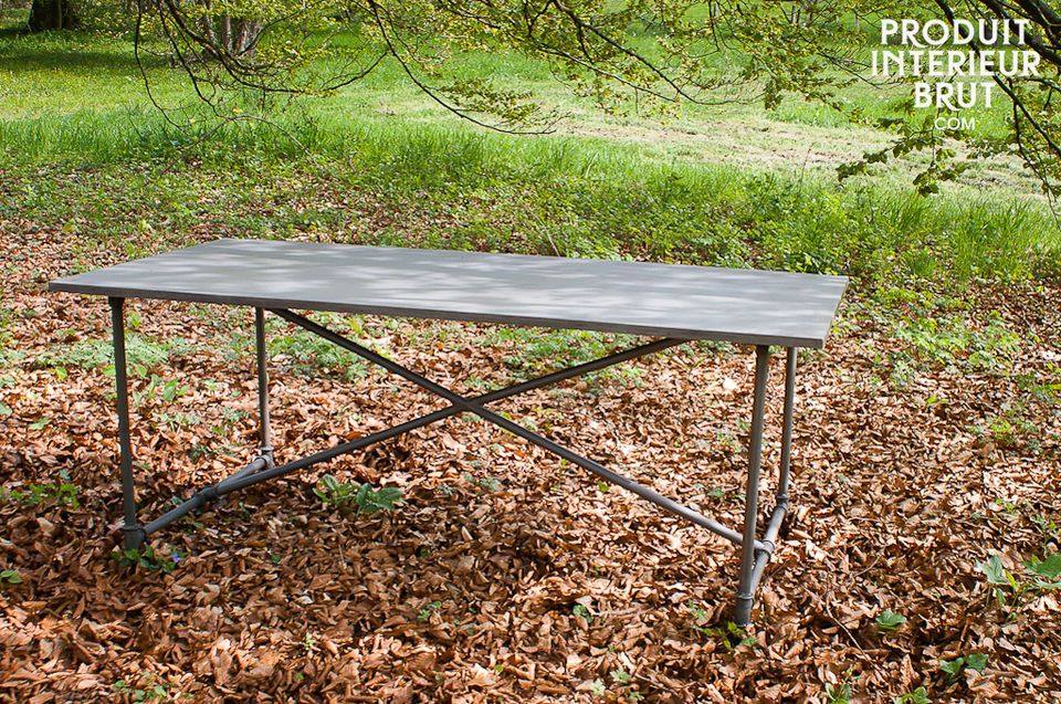 It has a metal tube leg assembly and a metal top, which is rare for a table of this size