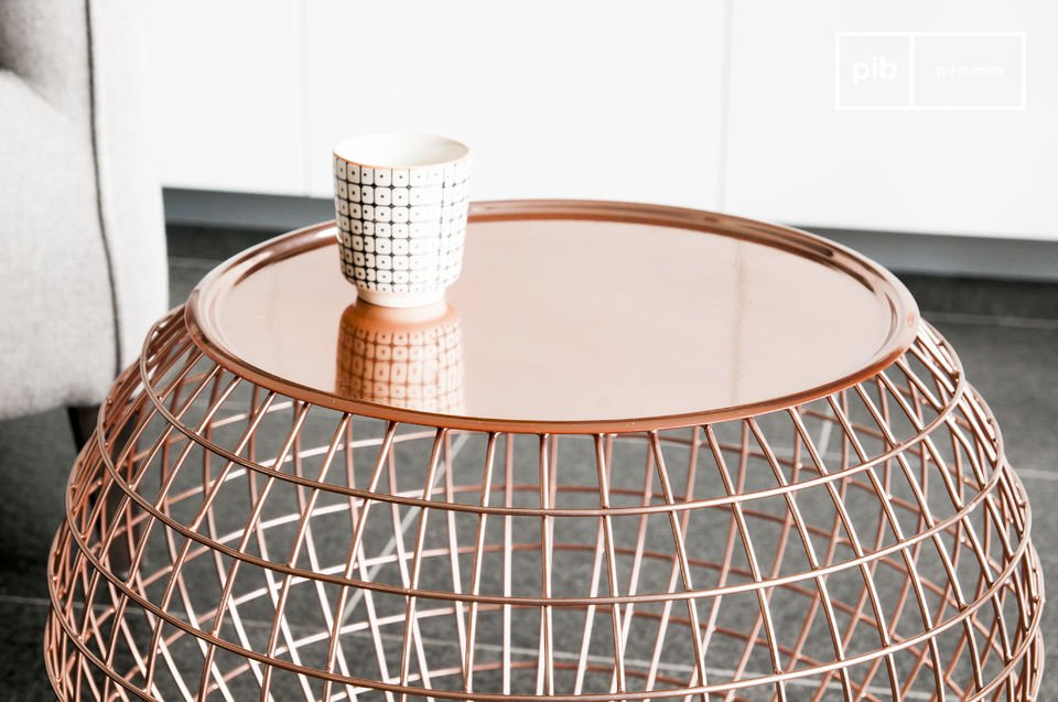 Copper-coloured metal table with charming curves