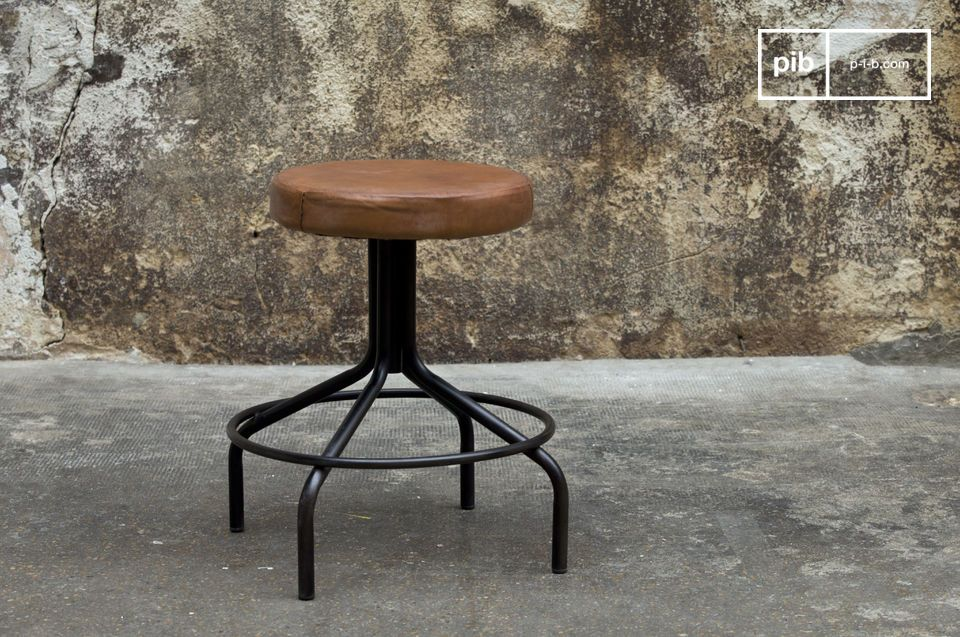Small stool in brown leather and black metal.