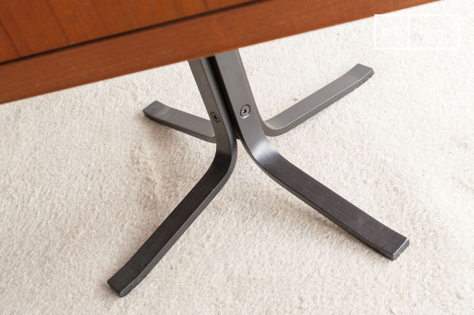 Elegant table base in contrasting black metal.