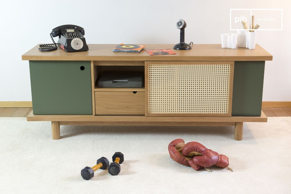 You can change the asymmetry of this sideboard by sliding the door