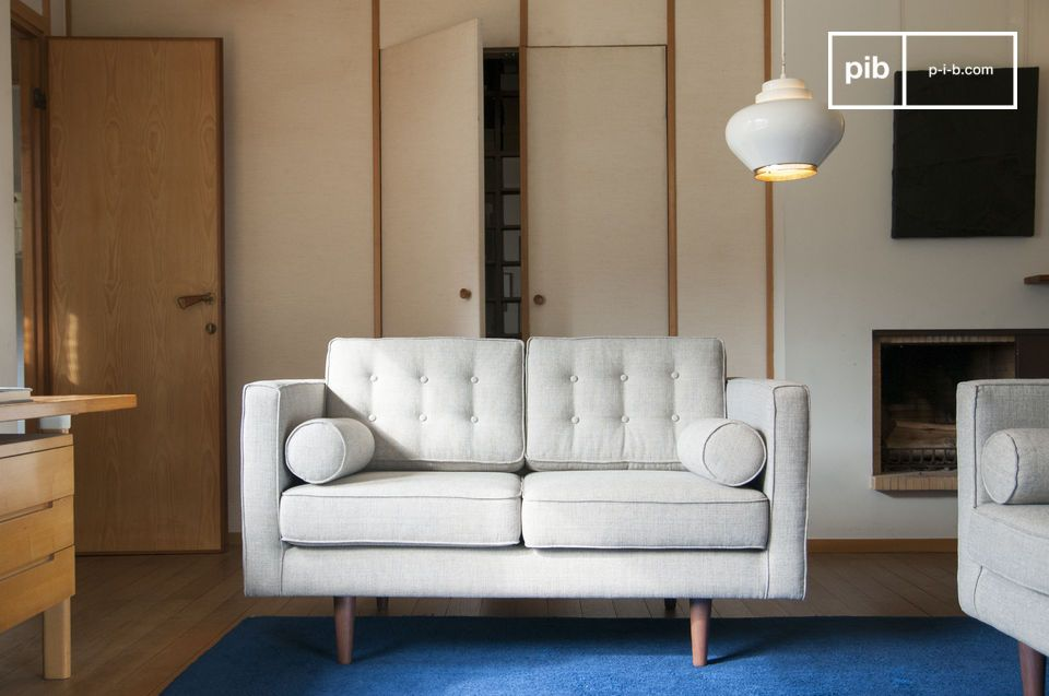 Two-seater sofa in light grey Scandinavian style.