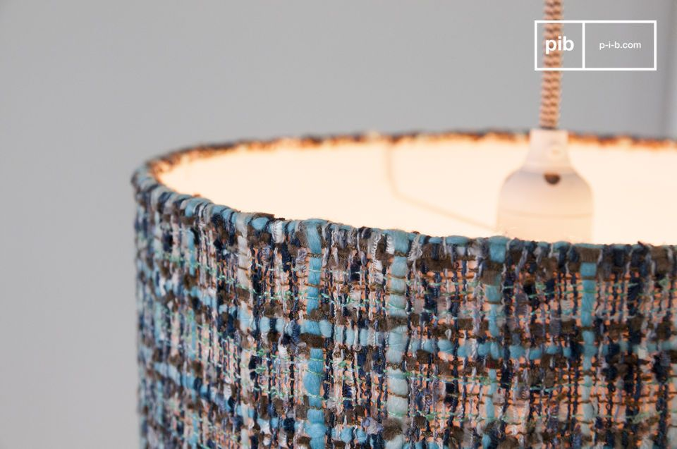 The lampshade is made of a blue knit fabric.