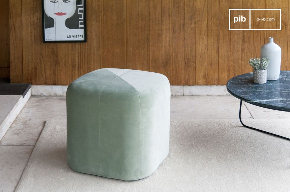 The pretty green velvet pouf changes colour with the brightness.