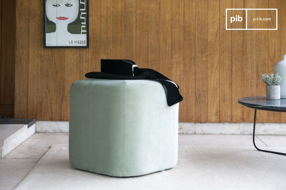 Small geometric velvet pouf with round corners.