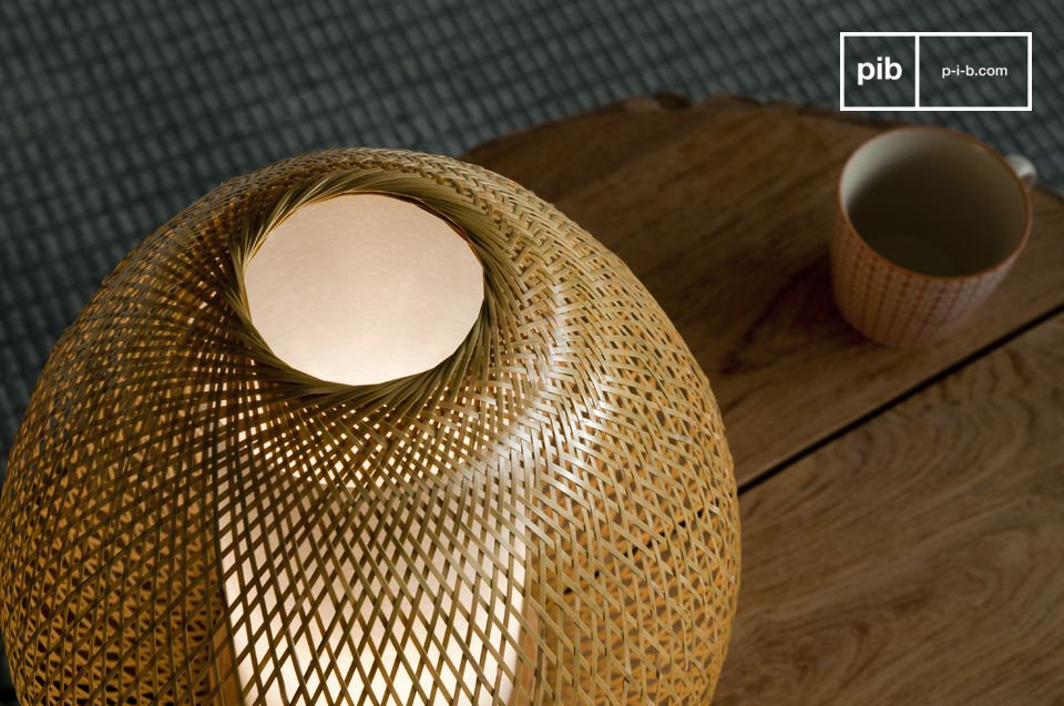Enjoy the work of weaving bamboo that contribute to this trendy lamp\'s lightness