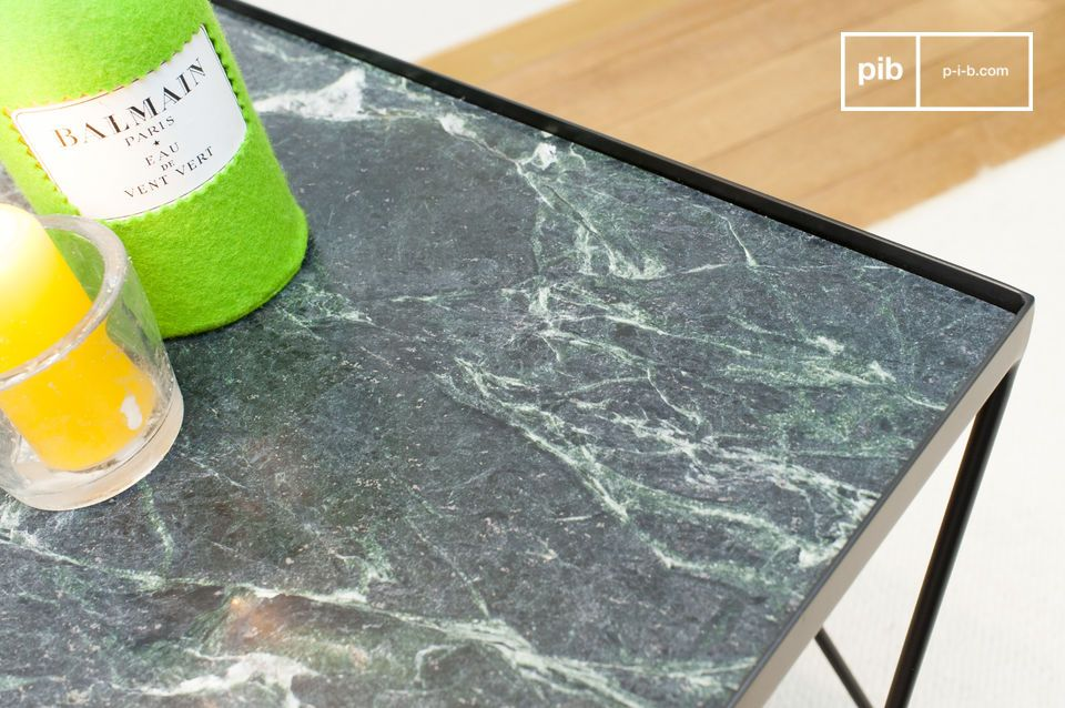 Deep green marble top with white veins.