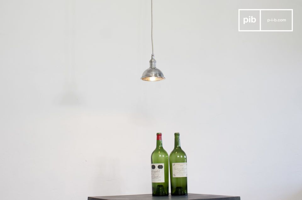 A well-crafted vintage pendant light made of silver-plated brass with a power cord that is wrapped