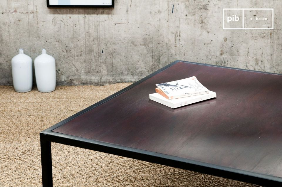 The thick table top of the Smoke coffee table has a varnished mahogany coloured finish