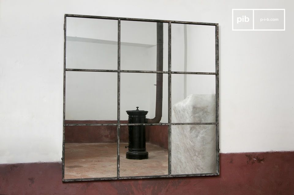 the mirror frame divides the mirror into nine separate squares.