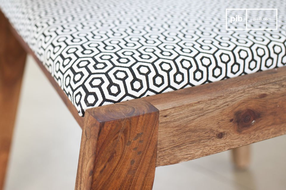 This beautiful chair has a combination of a solid acacia wood structure, and a retro patterned fabric
