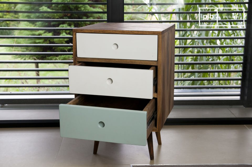 Practical and totally retro, the Stockholm block chest of drawers plays on the contrast between pale colours and natural wood