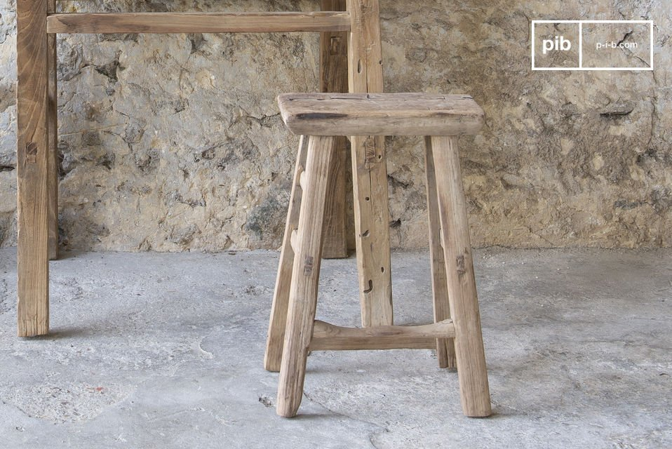 A robust and lightweight wooden stool that is made out of old wood