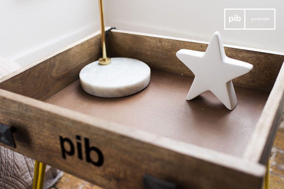 Composée d\'un véritable tiroir posé sur des pieds métallique jaunes légèrement évasés