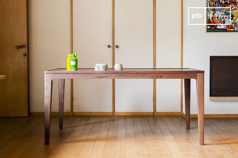 This Scandinavian dining table made out of walnut wood is reminiscent of Scandinavian furniture from