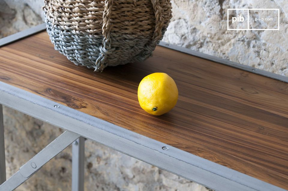 The pretty tray is made of varnished solid teak.