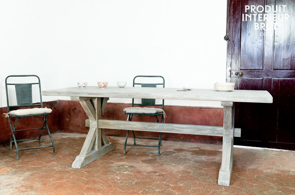 This design with distressed hard teak and its traditional wooden base confers to this table a unique