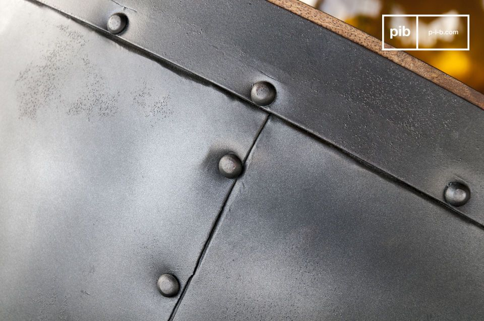 The table structure is decorated with pretty black rivets.