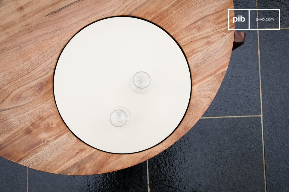 This original coffee table has a beautiful white plate integrated into the round tabletop made of