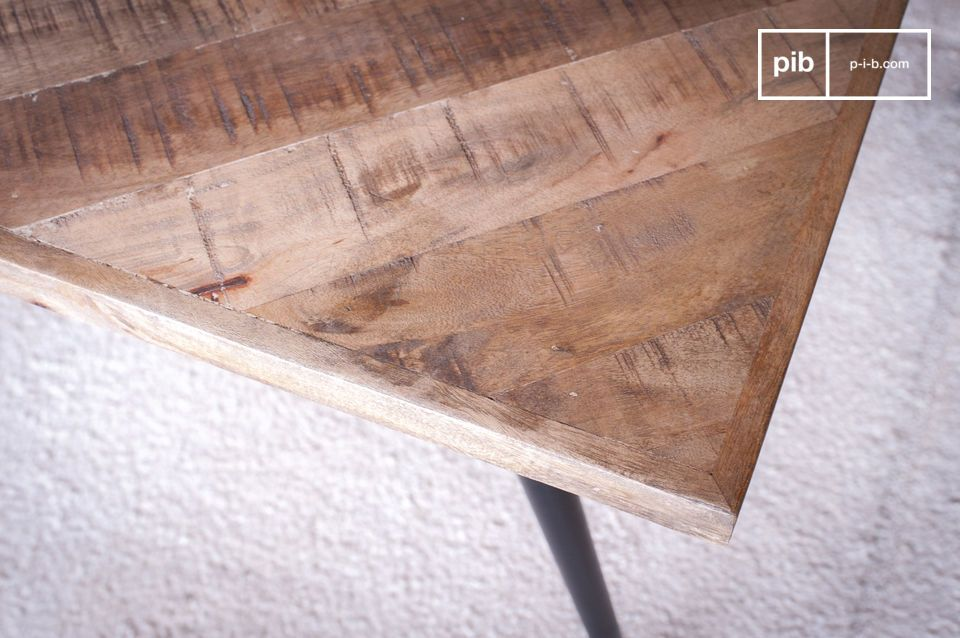 The wooden top consists of a herringbone assembly of dozens of pieces of wood