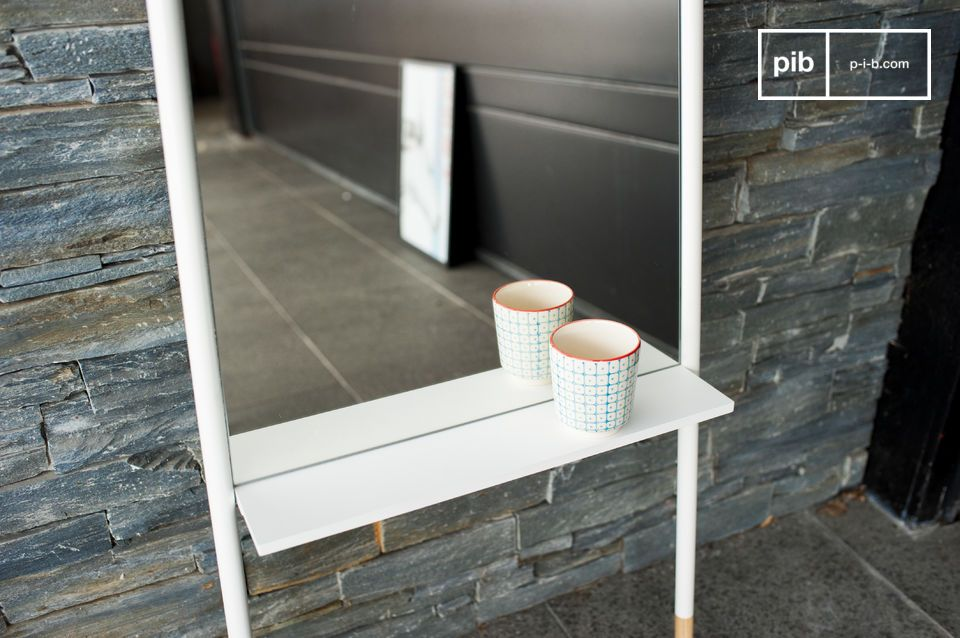 The mirror has a shelf for placing objects.