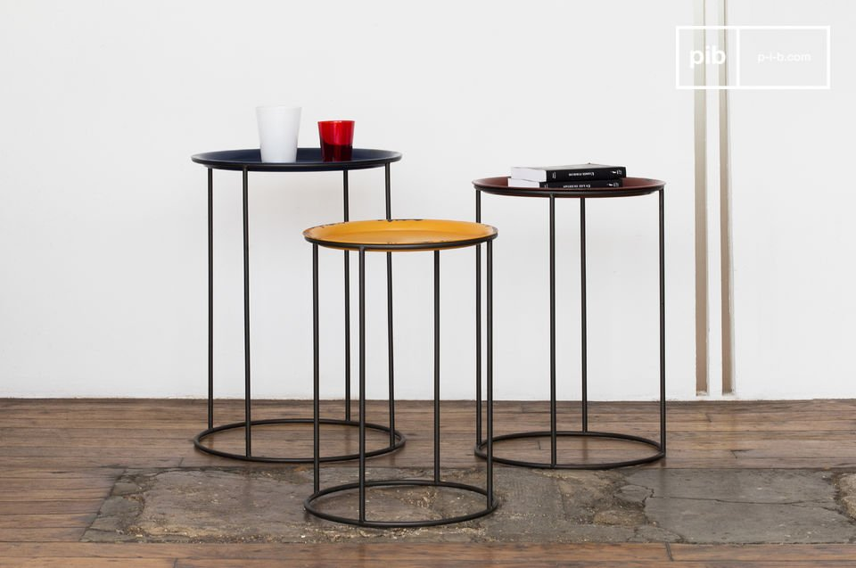 Entirely designed with metal, these three tables can be used in unison to create a long coffee table, or seperately at the ends of a sofa or as a bedside table