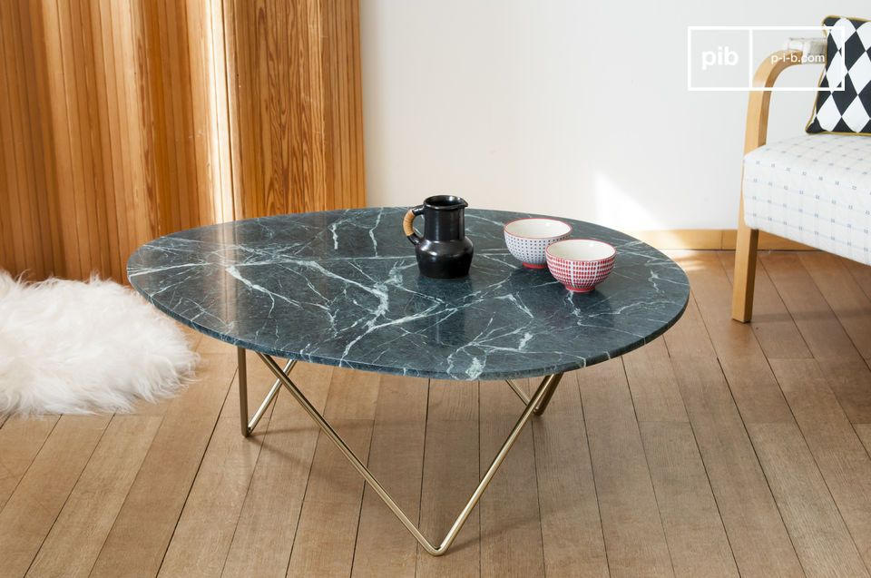A marble coffee table that plays with the association of forms.