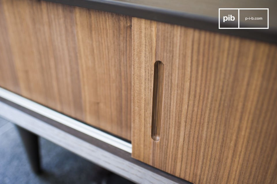 The matte brown coloured finish makes for a beautiful contrast with the oak panels which act as sliding doors that are leant to hide your audio-visual equipment