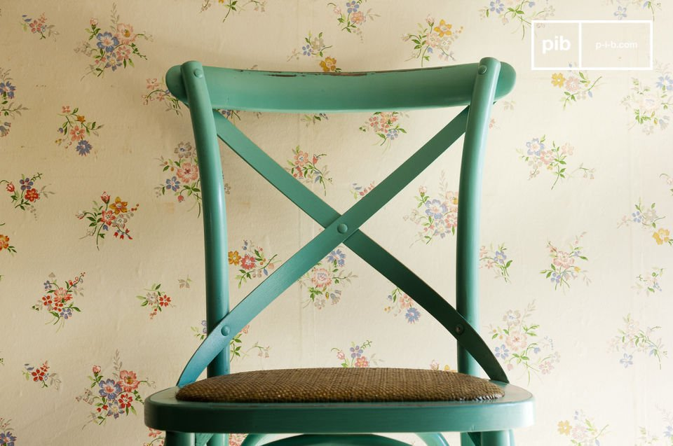 The chair Pampelune is extremely comfortable, with its dense wicker-padded seat and its \
