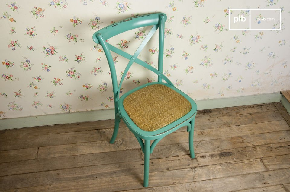 Choose this distressed beech wood chair for a touch of retro charm close to your table
