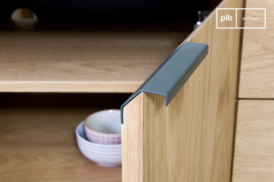 The handles offer an aesthetic contrast with the light oak.
