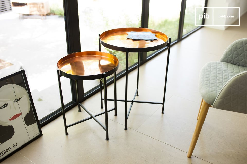 These two tables are entirely made of robust, black steel and tabletops, which have a copper-coloured finish