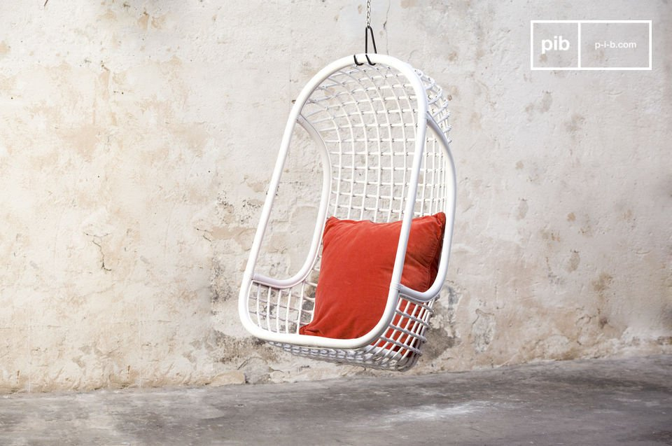 Opt for a hanging chair made of white rattan with retro flair in a comfortable northern style