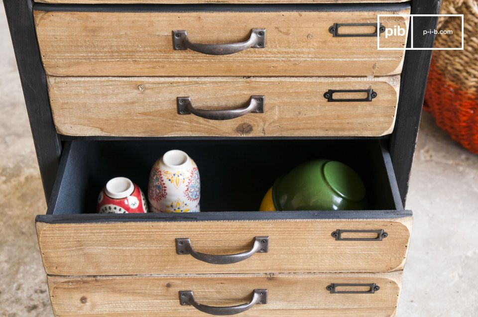 Several industrial-style drawers allow for easy storage.