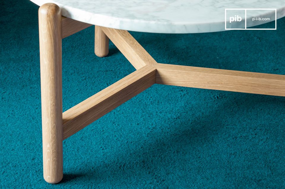 Made of solid oak, the base is attached to the white marble top by screws