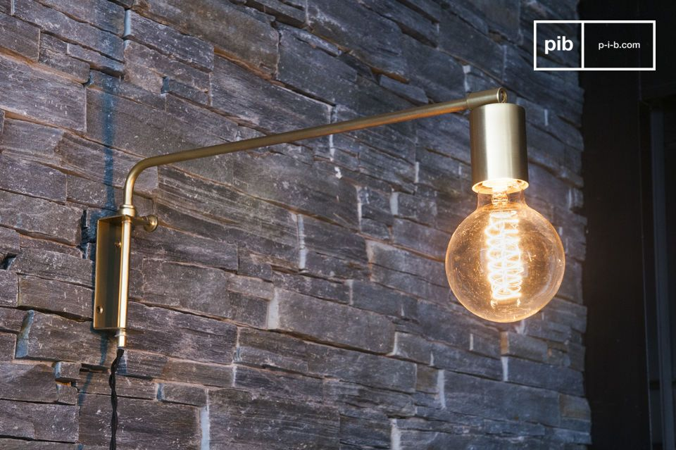 Nice golden wall lamp with exposed bulb.