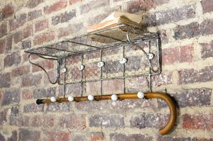 Wire mesh shelf with numbered hooks