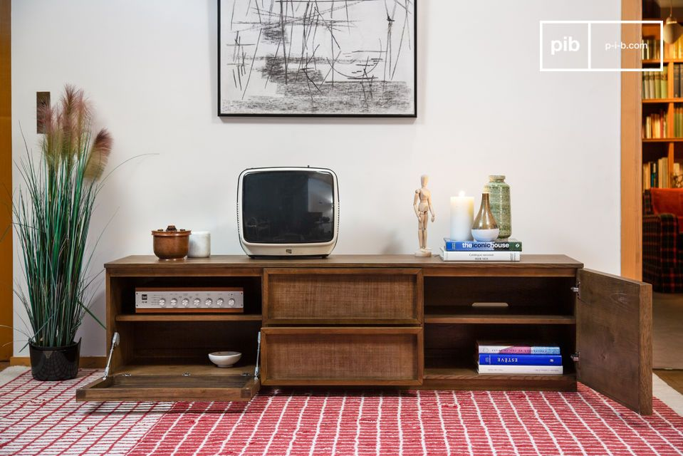 A large TV cabinet with openwork doors