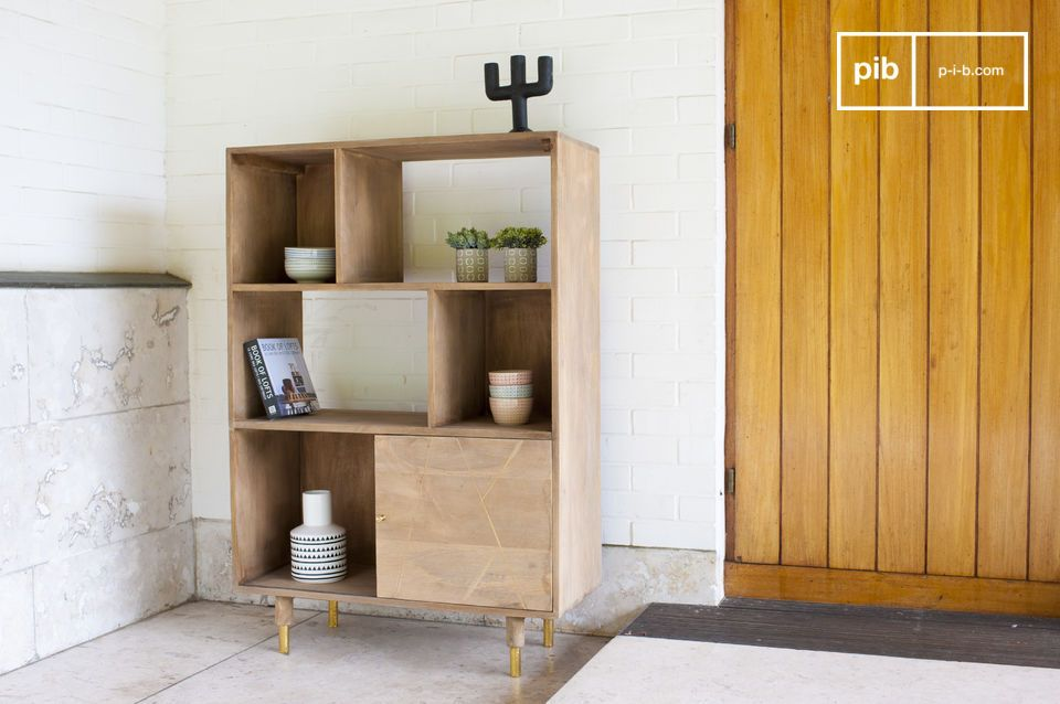 The Wooden bookcase Messinki has a few golden accents that give it its originality