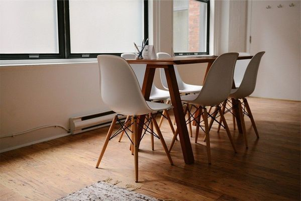 wooden scandinavian table with nordic chairs