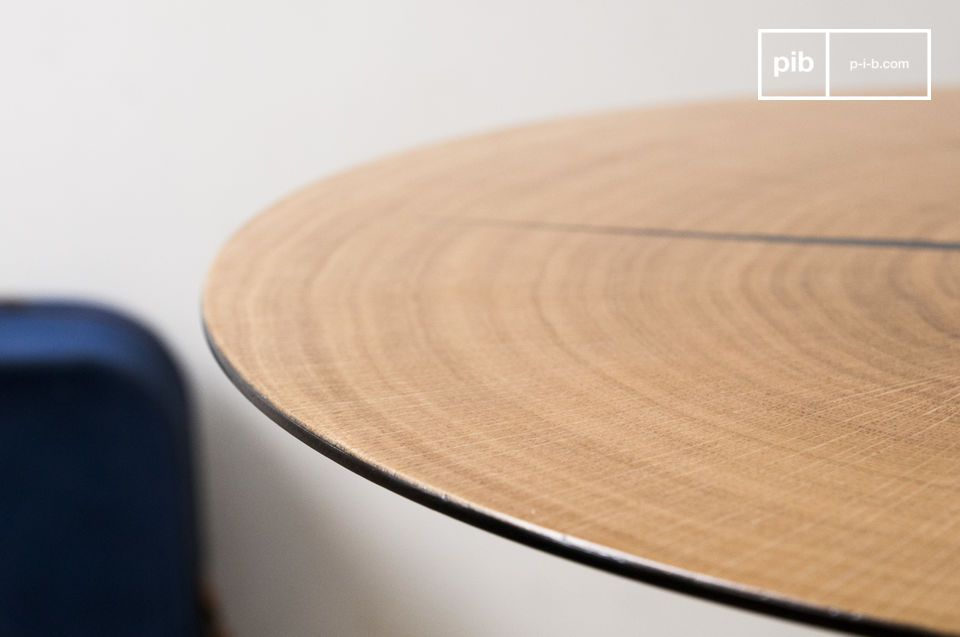The Xyleme side table is composed of a thin section of light oak wood applied to a round metal top