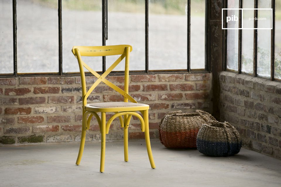 Entirely made out of beech, this chair is painted in a beautiful patinated yellow colour that confers to the chair an aged look and a great charm